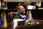 Nevada Senate Minority Leader Aaron Ford, D-Las Vegas, works on the Senate floor at the Legislative Building in Carson City, Nev., on Friday, April 3, 2015. <br /> Photo by Cathleen Allison