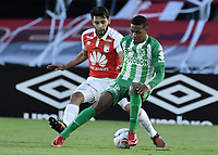 BOGOTÁ - COLOMBIA, 28-07-2018: Nicolas Gil (Izq.) jugador de Santa Fe disputa el balón con Jeison Steven Lucumi (Der.) jugador del Nacional durante el encuentro entre Independiente Santa Fe y Atlético Nacional por la fecha 2 de la Liga Águila II 2018 jugado en el estadio Nemesio Camacho El Campin de la ciudad de Bogotá. / Nicolas Gil (L) player of Santa Fe struggles for the ball with Jeison Steven Lucumi (R) player of Nacional during match between Independiente Santa Fe and Atletico Nacional for the date 2 of the Aguila League II 2018 played at the Nemesio Camacho El Campin Stadium in Bogota city. Photo: VizzorImage/ Gabriel Aponte / Staff
