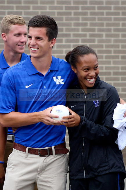 Men's and women's soccer players come together for the special the dedication ceremony of the Wendell and Vickie Bell Soccer Complex in Lexington, Ky., on Sunday, August 31, 2014. Photo by Jonathan Krueger | Staff