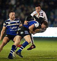 Rhys Priestland of Bath Rugby puts in a big tackle on Lloyd Evans of Gloucester Rugby. Premiership Rugby Cup match, between Bath Rugby and Gloucester Rugby on February 3, 2019 at the Recreation Ground in Bath, England. Photo by: Patrick Khachfe / Onside Images