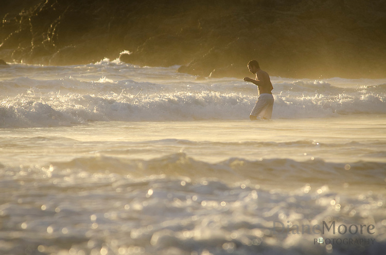 Man in Waves Costa Rica Sunset