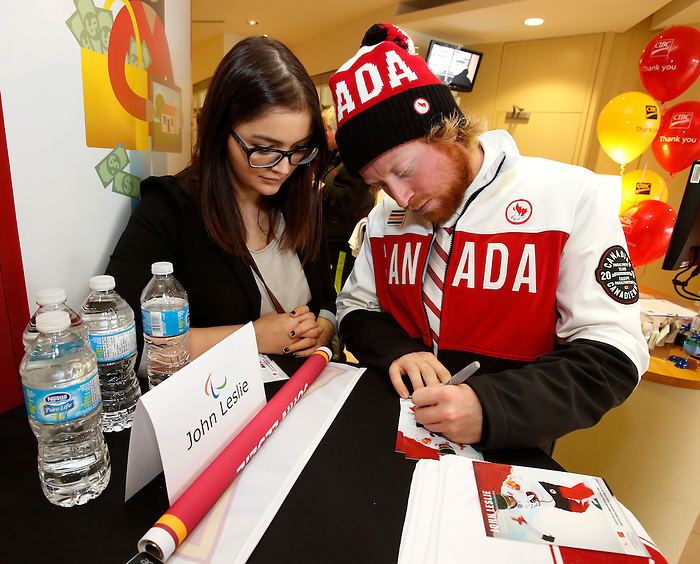Ottawa, ON - March 28 2014 - John Leslie of the para-snowboard team signs autographs at the CIBC Paralympic Welcome Home Event at CIBC South Keys Banking Centre in Ottawa (Photo: Patrick Doyle/CIBC)