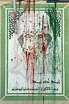 Sco0033837 .  Daily Telegraph..A defaced Portrait of Muammar Gadaffi in central Tripoli...Tripoli 9 September 2011