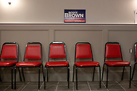 A campaign sign hangs on a wall after Senator Scott Brown (R-MA) spoke to a crowd gathered the VFW Post 88 for a campaign stop in North Billerica, Massachusetts, USA, on Thurs., Nov. 2, 2012. Senator Scott Brown is seeking re-election to the Senate.  His opponent is Elizabeth Warren, a democrat.