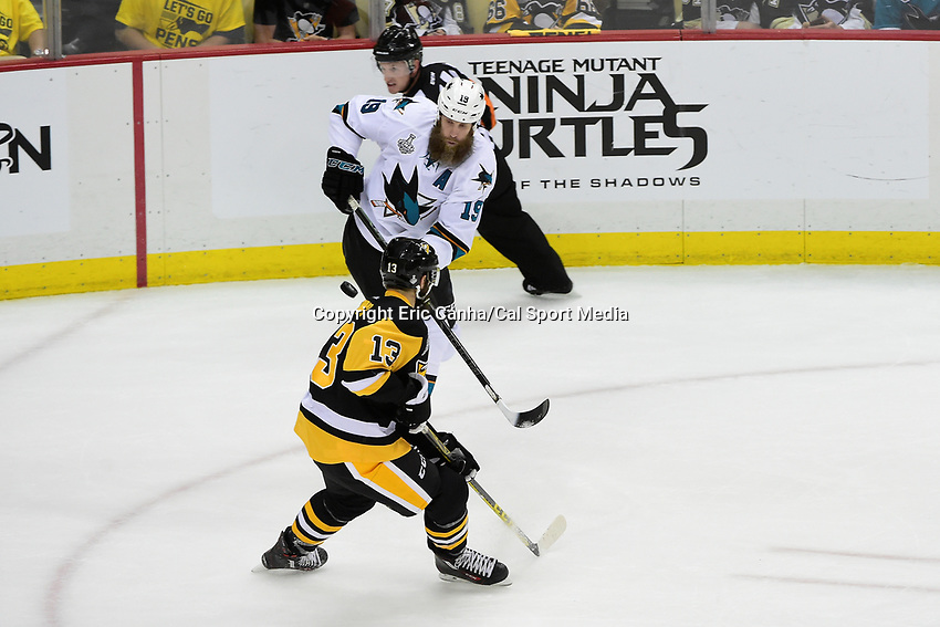 Wednesday, June 1, 2016: San Jose Sharks center Joe Thornton (19) passes the puck behind Pittsburgh Penguins center Nick Bonino (13) during game 2 of the NHL Stanley Cup Finals  between the San Jose Sharks and the Pittsburgh Penguins held at the CONSOL Energy Center in Pittsburgh Pennsylvania. Pittsburgh beats San Jose 2-1 in overtime and leads the best of 7 series 2-0. Eric Canha/CSM