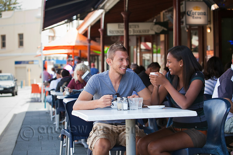 Couple drinking coffee at a cafe on South Terrace.  Fremantle, Western Australia, Australia