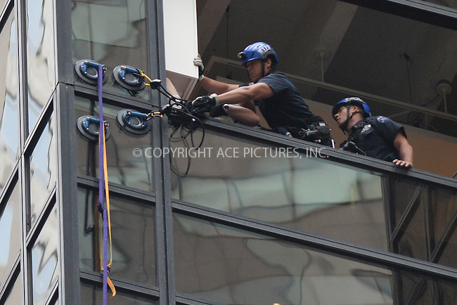www.acepixs.com<br /> August 10, 2016 New York City<br /> <br /> A man was seen climbing Trump Tower with giant suction cups in York City on August 10, 2016.<br /> <br /> Credit: Kristin Callahan/ACE Pictures<br /> <br /> tel: 646 769 0430<br /> Email: info@acepixs.com