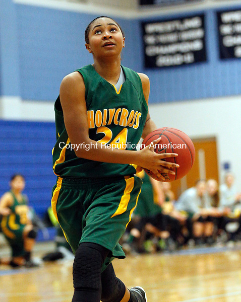 Oxford, CT- 21 January 2016-012116CM07- News action woman--- Holy Cross' RaShana Siders takes the ball to the hoop against Oxford on Thursday.    Christopher Massa Republican-American