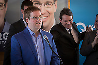 PQ Leadership candidate Pierre-Karl Peladeau touches PQ candidate for the riding of Jean-Talon Clement Laberge during the presentation of parti Quebecois candidates for the upcoming byelection Tuesday May 5, 2015.<br /> <br /> PHOTO :  Francis Vachon - Agence Quebec Presse