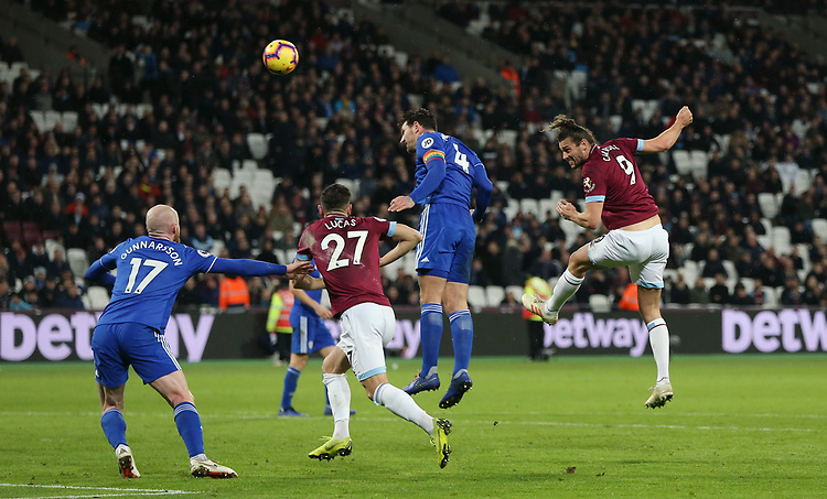 West Ham United's Andy Carroll with a header towards goal<br /> <br /> Photographer Rob Newell/CameraSport<br /> <br /> The Premier League - West Ham United v Cardiff City - Tuesday 4th December 2018 - London Stadium - London<br /> <br /> World Copyright © 2018 CameraSport. All rights reserved. 43 Linden Ave. Countesthorpe. Leicester. England. LE8 5PG - Tel: +44 (0) 116 277 4147 - admin@camerasport.com - www.camerasport.com
