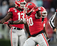 ATHENS, GA - OCTOBER 19: Tae Crowder #30 of the Georgia Bulldogs celebrates a play during a game between University of Kentucky Wildcats and University of Georgia Bulldogs at Sanford Stadium on October 19, 2019 in Athens, Georgia.