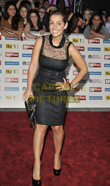 Louise Redknapp.'The Daily Mirror's Pride Of Britain Awards 2011' at Grosvenor House Hotel, London, England..3rd October 2011.full length black dress hand on hip sleeveless lace clutch bag smiling .CAP/CAN.©Can Nguyen/Capital Pictures.
