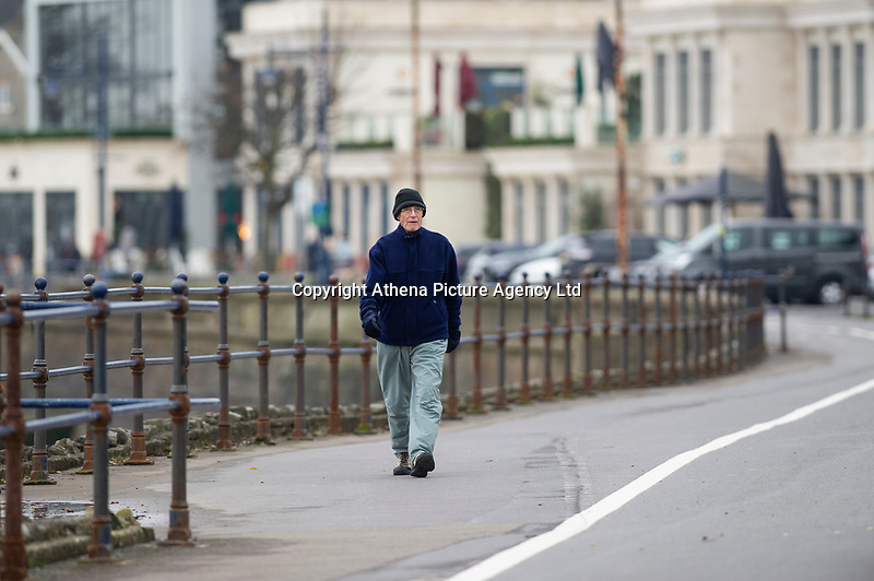 Pictured: A man walks on Mumbles Sea Front, Swansea, Wales, UK. Thursday 31 January 2019<br /> Re: