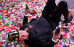 NEW YORK - JANUARY 01: A man rolls around in confetti on New Year's eve in Times Square in New York City just after midnight on January 01, 2017. (Photo by Yana Paskova/Getty Images)