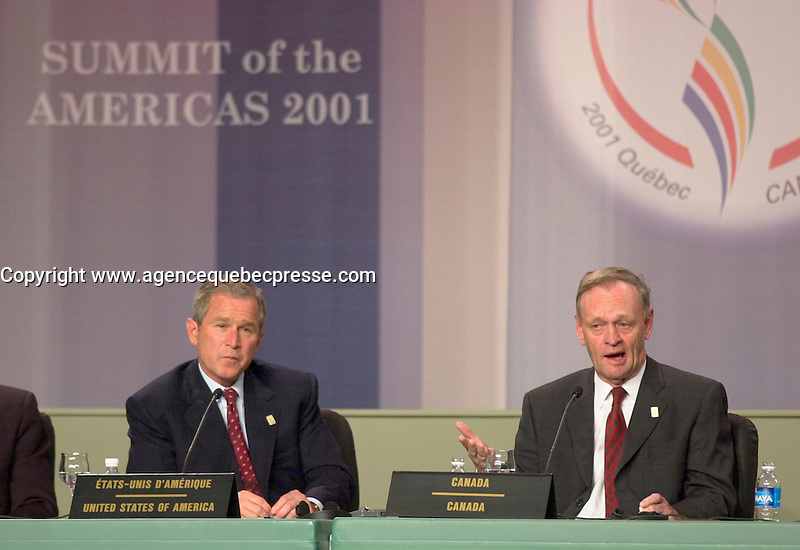 April 22,  2001, Quebecl, Quebec, Canada<br /> <br /> George W, Bush, United States of Americas President (R)  listen while <br /> Jean Chretien, Canada's Prime Minister (L) speak at the closing press conference of the Summit of the Americas , April 22, 2001 in Quebec City, CANADA.<br /> <br /> Both leader agreed to meet before the upcoming G-8 meeting this spring in Alberta, Canada.<br /> <br /> Mandatory Credit: Photo by Pierre Roussel- Images Distribution. (&copy;) Copyright 2001 by Pierre Roussel <br /> ON SPEC<br /> NOTE l Nikon D-1 jpeg opened with Qimage icc profile, saved in Adobe 1998 RGB.