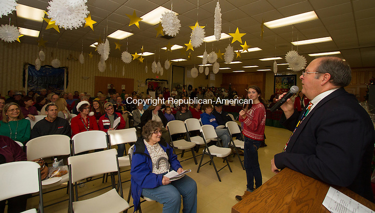 SOUTHBURY, CT - 21 NOVEMBER 2015 -112115JW8.jpg -- Auctioneer Paul Stansel auctions off a dinner as Volunteer Chrissy Schultz holding the plate lloks on during the United Church of Christ 49th Annual Holiday Fair Saturday afternoon.  Jonathan Wilcox Republican-American