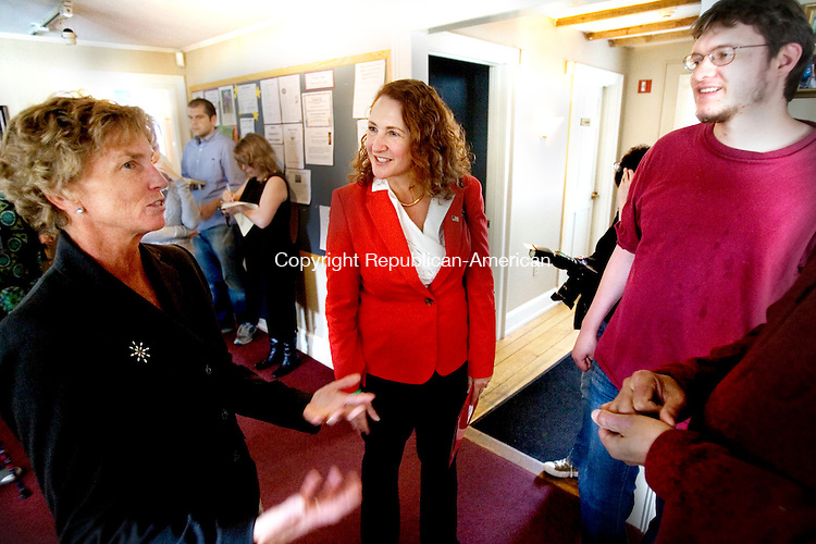 TORRINGTON CT. 25 April 2014-042517SV08-From left, Lisa Lynch, executive director talks with Rep. Elizabeth H. Esty, D-5th District during a visit by Esty at the Prime Time House campus on Main Street in Torrington Friday. The mission of Prime Time House, Inc. is to assist adults with serious mental illness find pathways back to independence and productivity. All pathways offer unlimited opportunities to access the same worlds of employment, education, housing, and friendship as the rest of society. At right, Mark Jones a volunteer at the Prime Time House. <br /> Steven Valenti Republican-American