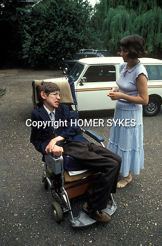 Professor Stephen Hawking leaving home in morning with wife Jane. He travels to college in his wheel chair. Cambridge UK 1981.