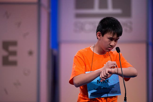 Speller 202 Max Lee spells his second word in the semi-final rounds of the Scripps National Spelling Bee at the Gaylord National Resort and Convention Center in Oxon Hill, Md., on Thursday,  May 31, 2012. Photo by Bill Clark