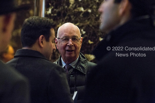 Klaus Schwab (C), Executive Chairman of the World Economic Forum, arrives in the lobby of Trump Tower in Manhattan, New York, U.S., on Tuesday, December 13, 2016. <br /> Credit: John Taggart / Pool via CNP