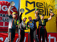 Oct 14, 2019; Concord, NC, USA; (From left) NHRA pro stock motorcycle rider Andrew Hines, top fuel driver Steve Torrence, funny car driver Robert Hight and pro stock driver Deric Kramer celebrate after winning the Carolina Nationals at zMax Dragway. Mandatory Credit: Mark J. Rebilas-USA TODAY Sports