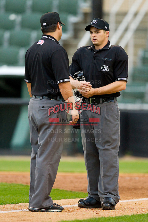 Base umpire Jorge Teran (left) checks on home plate umpire Drew Freed after Freed was hit on the right wrist by a pitch during the South Atlantic League game between the Delmarva Shorebirds and the Kannapolis Intimidators at CMC-Northeast Stadium on April 15, 2013 in Kannapolis, North Carolina.  The Shorebirds defeated the Intimidators 8-4.  (Brian Westerholt/Four Seam Images)