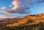Uncompahgre National Forest, Colorado: Sunset over the cliffs of the Cimarron with fall colored hillsides, San Juan Mountains