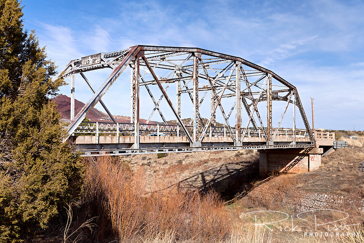 The Walnut Canyon Bridge across Walnut Creek on an old alignment of Route 66 in Winona, Arizona. Built in 1924 as part of the Flagstaff-Winslow road the 110 foot long Parker through truss bridge carried Route 66 traffic until 1937 when The Mother Road was routed south. The town of Winona was not as prosperous as many of the other small towns along 66 and gained its greatest notoriety by being mentioned in Bobby Troup's Route 66 song. In 1988 the National Park Service listed the Walnut Canyon Bridge in the National Register of Historic Places.
