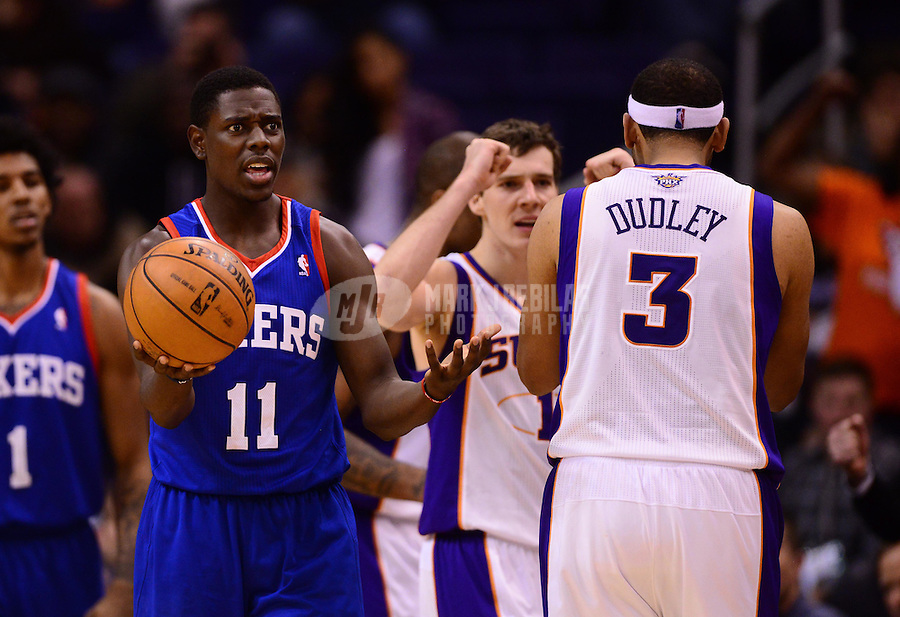 Jan. 2, 2013; Phoenix, AZ, USA: Philadelphia 76ers guard Jrue Holiday (11) reacts to a refs call as Phoenix Suns players celebrate in the fourth quarter at the US Airways Center. The Suns defeated the 76ers 95-89. Mandatory Credit: Mark J. Rebilas-USA TODAY Sports