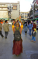 Prostration in Tibet is an important expression of devotion to Tibetan Buddhism. Prostrating is practicing one of Buddhism's three Jewels for Tibetan Buddhists. Tibetan pilgrims prostrate themselves by lying face-down on the ground and stretching out their arms and legs so as to earn merit.<br />