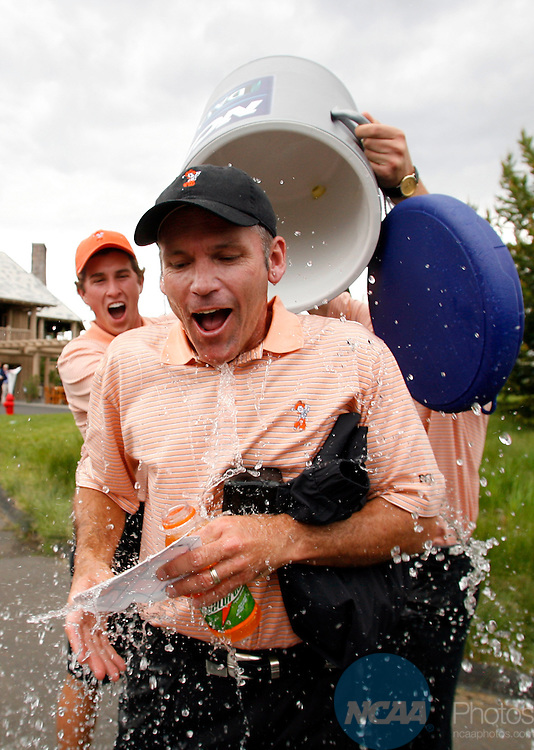 03 JUNE 2006:  Oklahoma State University Head Coach Mike McGraw gets showered with water after winning the Division I Men's Golf Championship held at the Crosswater Golf Club at Sunriver Resort in Sunriver, OR.  Oklahoma State won the team national title with a -9 score.  Jamie Schwaberow/NCAA Photos