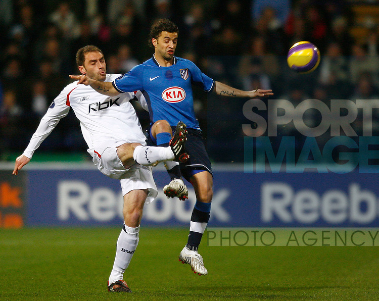 Bolton Wanderers Nicky Hunt challenges Simao Fonseca of Atletico Madrid