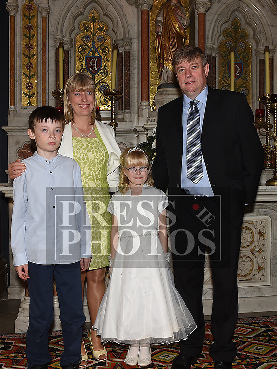 Maja Rafferty who received her First Holy Communion in St. Peters Church pictured with parents Michael and Helen and brother James. Photo:Colin Bell/pressphotos.ie