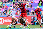 Perry Baker of USA (L) tackles Cai Devine of Wales (R) during the HSBC Hong Kong Sevens 2018 match between USA and Wales on April 7, 2018 in Hong Kong, Hong Kong. Photo by Marcio Rodrigo Machado / Power Sport Images