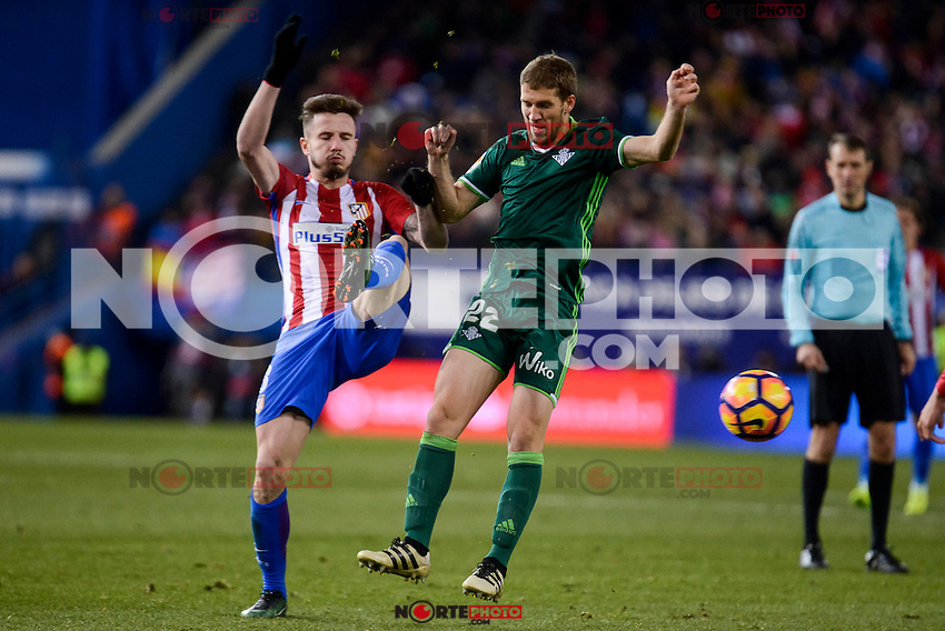 Atletico de Madrid's Saúl Ñígez and Real Betis's Darko Brasanac during La Liga match between Atletico de Madrid and Real Betis at Vicente Calderon Stadium in Madrid, Spain. January 14, 2017. (ALTERPHOTOS/BorjaB.Hojas) /NORTEPHOTO.COM