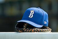 A Burlington Royals cap sits on top of the dugout during batting practice at Burlington Athletic Park in Burlington, NC, Thursday, July 12, 2007.