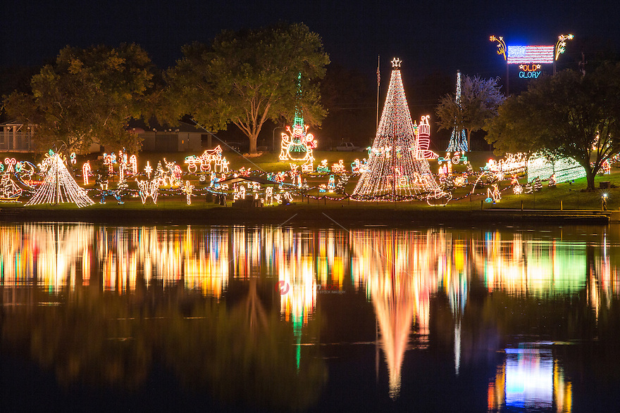 From November 22-January 1, the Marble Falls Walkway of Lights transforms the shoreline of Lake Marble Falls into a Christmas trail of twinkling sculptures, trees, and winter scenes. - Stock Image.