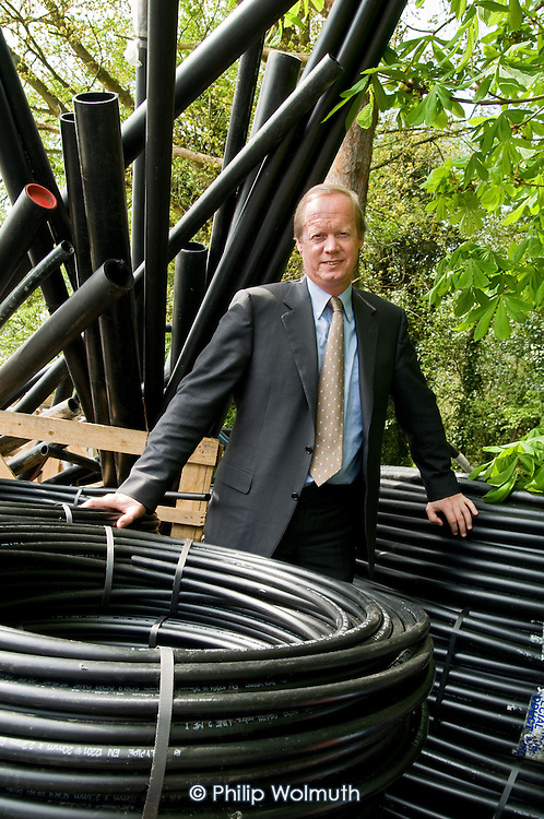 Justin Broadbent, of ISOenergy sustainable energy systems, with piping used for ground source heat pumps.
