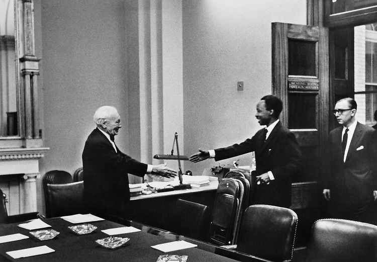 Rep. Barratt O'Hara shaking hands with statesman and diplomat. (Photo by CQ Roll Call)