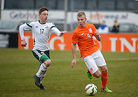20150314 - GENDT , NETHERLANDS  : Dutch Rick Van Drongelen (5) pictured in action with Northern-Irish Matthew Shevlin (17)  during the soccer match between Under 17 teams of  The Netherlands and Northern Ireland , on the second matchday in group 3 of the UEFA Elite Round Under 17 at De Bataven Stadion , Gendt , The Netherlands . Saturday  14 th March 2015 . PHOTO DAVID CATRY