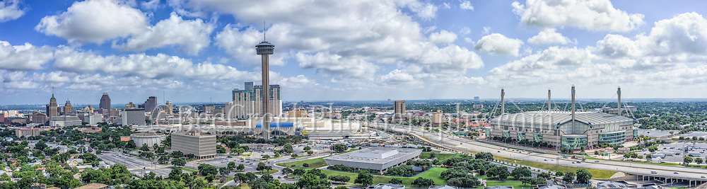 We took this aerial San Antonio skyline panorama so it would show downtown buildings along with the Hemisphere and Alamo Dome.  This scene includes the San Antonio Skyline with the Tower of Americas and behind it is the new Henry B Gonzales convention with the Hemisphere which stands 750 ft along with the Grand Hyatt, Marriott, the Alamo Dome, UT SA, Tower Life building, Bank of American Plaza and many others,