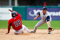 Second baseman Andrew Garcia #6 of the Charlotte Knights reaches for a wide throw as Tony Thomas #18 of the Pawtucket Red Sox steals second base at McCoy Stadium on June 12, 2011 in Pawtucket, Rhode Island.  The Red Sox defeated the Knights 2-1.    Photo by Brian Westerholt / Four Seam Images