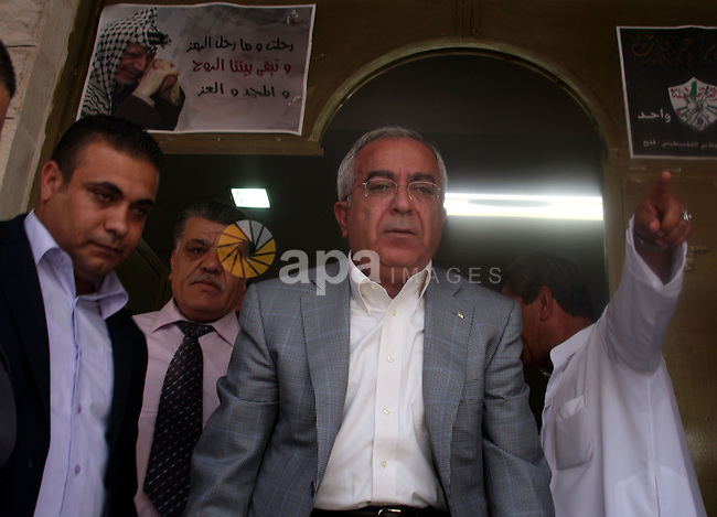 Palestinian Prime Minister Salam Fayyad arrives to take part in Friday prayer at a mosque after its been under renovations since fire was set to it in the beginning of April at the West Bank  village of Luba a-Sharkiyeh near the West Bank city of Nablus, Friday, June 11, 2010. Photo by Wadgi Eshtayah