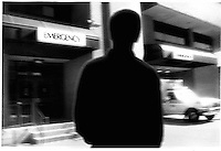 Silhouetted figure in front of hospital<br />