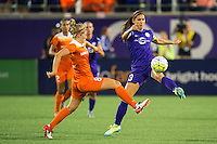 Orlando, Florida - Saturday, April 23, 2016: Orlando Pride forward Alex Morgan (13) is defended by Houston Dash defender Ellie Brush (8) while she plays the ball forward during an NWSL match between Orlando Pride and Houston Dash at the Orlando Citrus Bowl.
