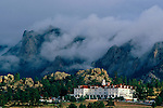 A morning storm encases the mountains, Lumpy Ridge, behind the historic Stanley Hotel, built in 1909 by F.O. Stanley in Estes Park, Colorado.