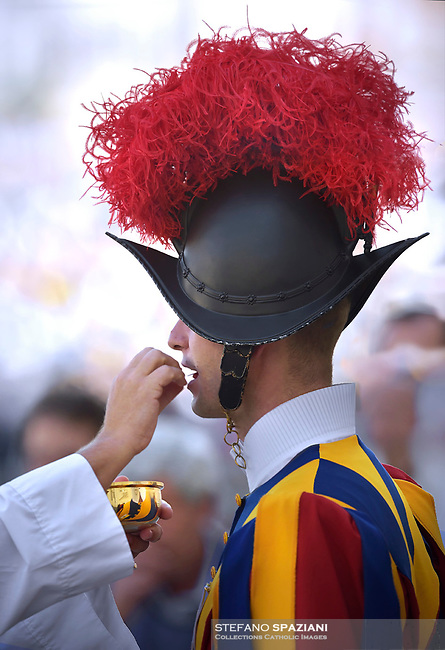 Swiss Guard receives communion.Pope Francis presides over a canonization ceremony in St Peter's Square at the Vatican, on October 14, 2018. Pope Francis canonizes two of the most important and figures of the 20th-century Catholic Church, declaring Pope Paul VI and the martyred Salvadoran Archbishop Oscar Romero.