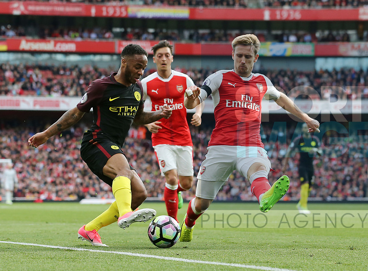 Arsenal's Nacho Monreal tussles with Manchester City's Raheem Sterling during the Premier League match at the Emirates Stadium, London. Picture date: April 2nd, 2017. Pic credit should read: David Klein/Sportimage