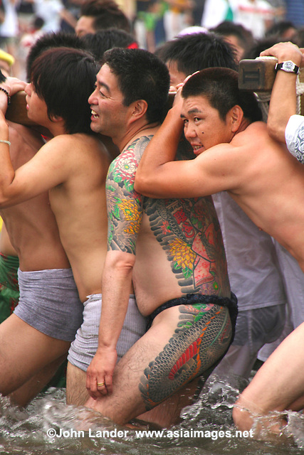 Gosho Shrine Matsuri, Kamakura - Japanese festivals are traditional festive occasions.  Matsuri is the Japanese word for festival.  These events are normally sponsored by a local shrine.  Matsuri almost always feature processions with mikoshi or portable shrines, that are carried around the neighborhood and even into the ocean along coastal areas such as Kamakura.