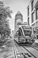 This is the Austin Rail in a almost black and white version of the Metro Rail as it leave downtown.